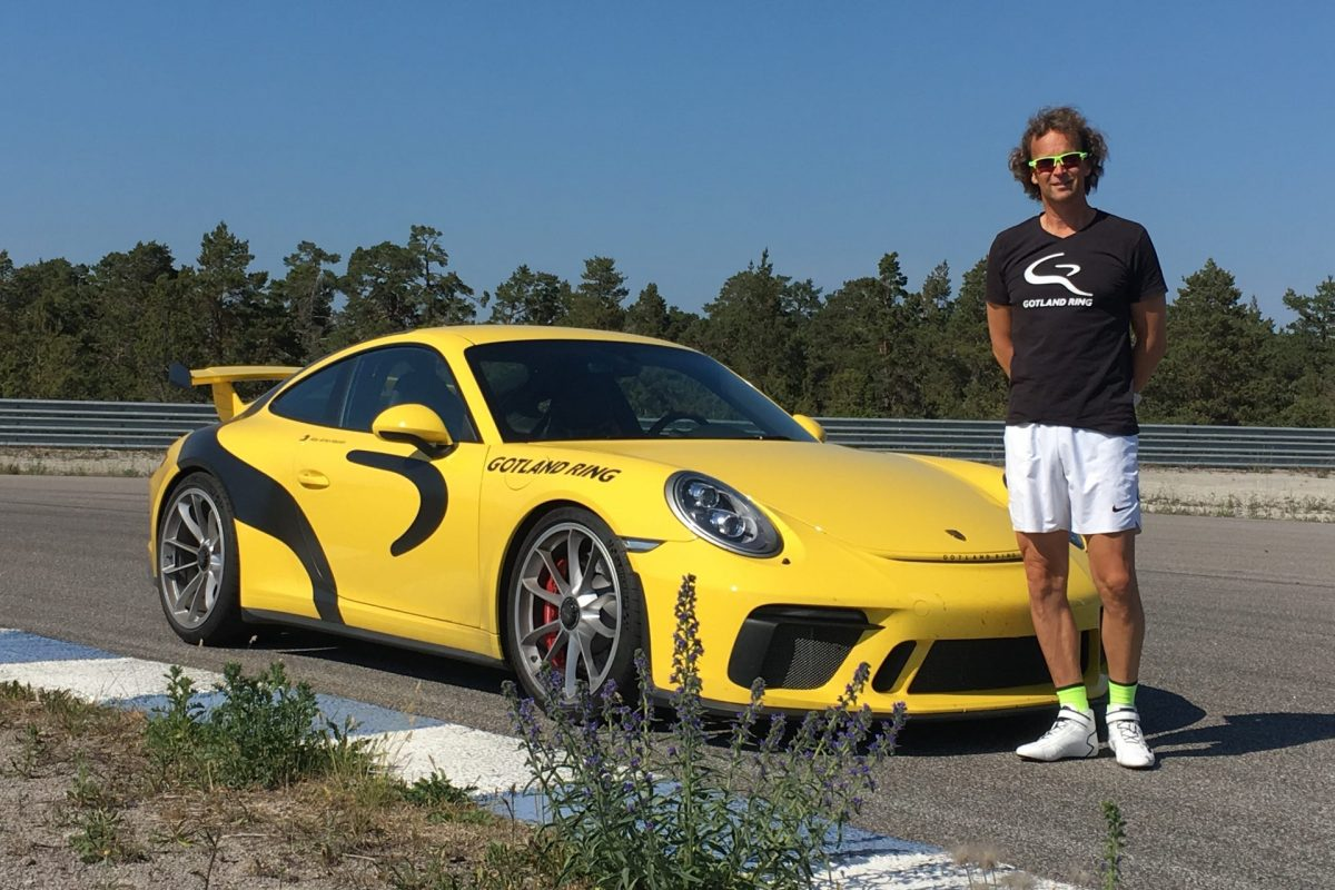 A yellow racing car and its driver