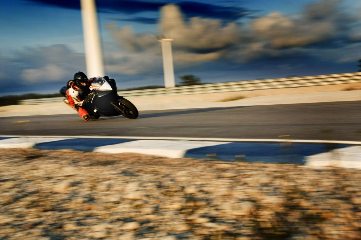A black motorcycle in the race track