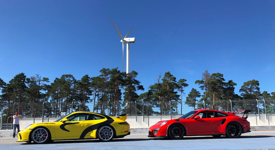 Red and yellow car on a race track