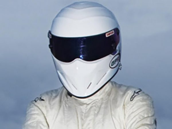 Racer in white helmet and suit